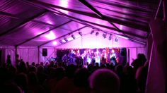 Marquee with stage, sound system & lighting, installed by www.24carrotevents.co.uk
