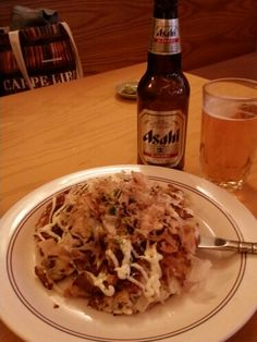 Okonomiyaki, essentially a Japanese frittata, with squid, protein (chicken in this case), chopped cabbage and other goodies.  A bit heavy on its own (the Asahi helps :) but enough to power some street climbing through SF Japantown.