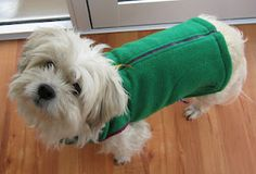 Doggy Coat TUTORIAL - Instructions on how to sew a childs polar fleece vest into a dog coat. Bad link - could use zipper sweater too Dog Coat Pattern, Dog Clothes Patterns, Dog Jacket, Puppy Clothes, Dog Sweaters, Dog Coats, Diy Stuffed Animals, Dog Accessories, Dog Life