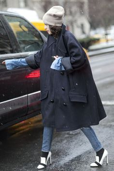 The Best Looks to Hit the Streets at NYFW, Day 2: Leandra Medine made an oversize swing coat the focal point.
