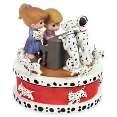 This figurine features Pongo and Perdita listening as two Precious Moments children serenade as Roger and Anita Radcliffe from 101 Dalmatians.