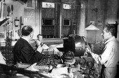 """Alfred Hitchcock setting up a scene for """"Rear Window"""" with Jimmy Stewart"""