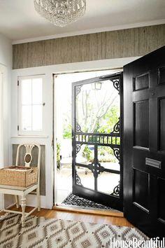 House Beautiful - entrances/foyers - black front foor, taupe raffia wallpaper