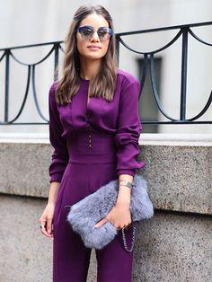 Camila Coelho's Magenta Jumpsuit & fur clutch at New York fashion Week, 2015.