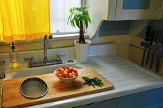 Use an over-the-sink cutting board to temporarily expand your counter space