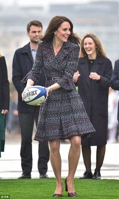 That's the spirit! Kate was seen playing rugby with a youngster outside the Musée d'Orsay ahead of the Six Nations match