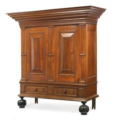 A WILLIAM AND MARY PANELED GUMWOOD KAST, attributed to the Elting-Beekman shops, probably Kingston, New York, Circa 1720.   Height 82 in. by Width 80 in. by Depth 31 in.