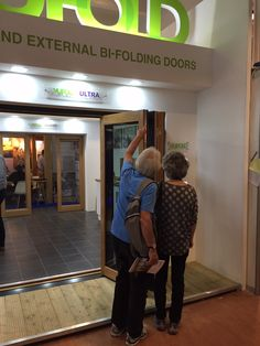 2 guests touching and feeling an Ultra Bifold Door set at The Southern Homebuilding & Renovating Show Door Sets, Folding Doors, Exhibitions, Building A House, The Past, Southern, Feelings, Accordion Doors, Pocket Doors
