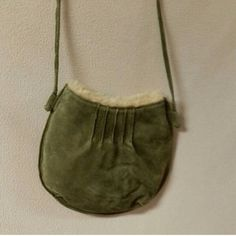 Wilsons Mini green leather bag Faux fur lined leather bag. Maybe used once. Wilsons Leather Bags