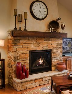 This is very similar to the fireplace we're putting into our basement, although the fireplace insert itself will be larger. Love the rustic, cottage feel it has!