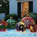 Outdoor Christmas decorations in the yard with large ornaments. You could do a smaller scale version of this with different sized kids toy inflatable balls Christmas Yard, Noel Christmas, Outdoor Christmas Decorations, Christmas Projects, Winter Christmas, Christmas Lights, Christmas Ornaments, Yard Ornaments, Christmas Chandelier
