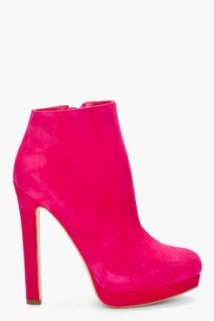 "ALEXANDER MCQUEEN //    Suede Ankle Booties    12259F128001    Suede ankle booties in hot pink. Almond toe. Concealed zip closure at inner ankle. Leather sole with approx. 5"" heel and .5"" platform. 100% leather. Made in Italy."