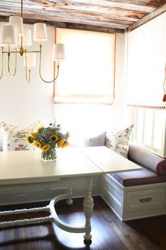 rustic cottage banquette.  drop-leaf table, reclaimed wood, and trimmed roman shades