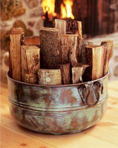 kindling in a patinaed copper bucket | http://www.potterybarn.com/products/paxton-copper-bucket/