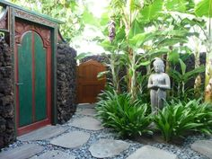 Rocks, Pavers, stones, Thick large grasses like this, for front of garage plante… - tropical garden ideas