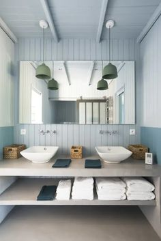 a modern light blue bathroom with beadboard, a concrete vanity and green pendant lamps over the sinks - DigsDigs Budget Bathroom, Bathroom Renovations, Bathroom Interior, Modern Bathroom, Small Bathroom, Bathroom Ideas, Master Bathroom, Blue Bathrooms Designs, Yellow Bathrooms