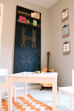 Peg board art with yarn, and mounted/painted clipboards to display pictures or art.