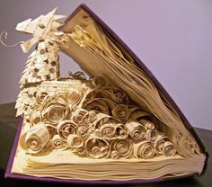made from pages of narnia books that were falling apart from being loved too much by brittney