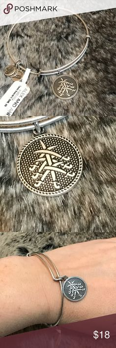 🔸SALE🔸 Alex & Ani 7 Swords expandable bangle This is new with tag!  Silver colored metal bangle bracelet that is expandable. 7  swords design on charm. Check out the TOP of my Closet for Current SALES! Alex & Ani Jewelry Bracelets