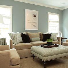 LIVING ROOMS: Ashley Goforth Design - blue, gray, walls, white, blue, mitered, pillows, tan, velvet, sofa, chairs, white, blue, greek, key, tufted, ottoman, nailhead trim, caster, legs, black, velvet, pillows, blue, skirted table, white, gourd, lamps, sisal rug,