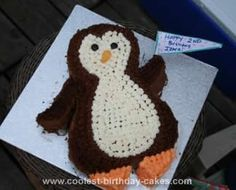 Homemade Penguin Birthday Cake: My daughter loves her stuffed penguin Pippy. It seemed to be the perfect cake choice for her second birthday. I drew the penguin outline, cut it out and