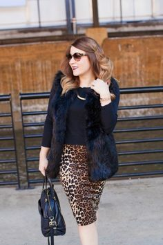 Glam leopard pencil skirt and a faux fur vest. #bloggerfavorites #outfit #inspiration