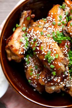 Spicy Sticky Chicken Wings: Glazed with a soy sauce, hoisin, and chili garlic glaze, these baked wings are so addictive. You won't want to share the bowl! | macheesmo.com
