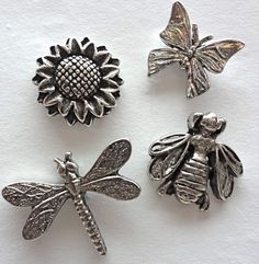Decorative Sun Flower, Butterfly, Dragonfly, & Bumble Bee Push Pins. Made in USA of lead free metal.  Has a nail on back to push into soft wood or bulletin board!