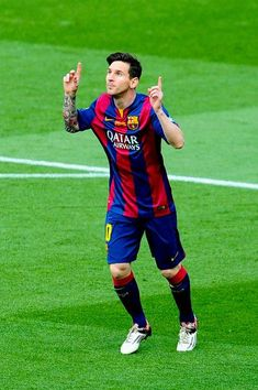 Lionel Messi of FC Barcelona celebrates after scoring the opening goal during the La Liga match between FC Barcelona and RC Deportivo de la Coruna at Camp Nou on May 23, 2015 in Barcelona, Catalonia.