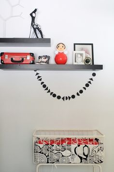 Simple black & white with pops of red ; loving the black geometric felt garland (find similar at www.facebook.com/booandbear.designs
