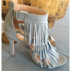"Fun Fringe Heels These light blue fringe heels are the perfect spring accessory! There's three layers of oh so fun fringe to dangle as you stride. The heel measures 4.5"".  These are new, and the box is included. Run true to size. PRICE IS FIRM. Fast shipping! Via Pinky Shoes Heels"