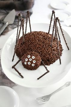 DIY Spider CakeWho knew sprinkle covered chocolate sticks could be so creepy as spider legs? For more DIY Halloween Cakes go here; for DIY Halloween Food and Drinks go here. Find the DIY Spider Cake Recipe from Sprinkle Bakes here. Halloween Desserts, Dulces Halloween, Halloween Torte, Pasteles Halloween, Theme Halloween, Halloween Food For Party, Halloween Treats, Halloween Foods, Halloween Spider
