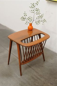 Arthur Umanoff magazine table - Hmmm.... trying to figure out how I could make a knock off.....Wire basket....