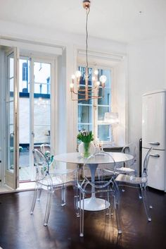 Acrylic dining chairs complete a modern living space that is both stylish and functional. Ikea Living Room, Ghost Chair Dining Room, Home, Acrylic Dining Chairs, Ghost Chairs Dining, Dining Room Inspiration, Living Room Designs, Interior Design, House Interior