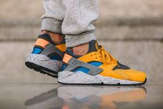 619f747d480b Nike Air Huarache SE Gold Leaf with Hyper Cobalt accents features Grey  detailing on the tongue