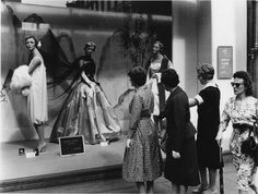 A group of women looking at a window display at Selfridges department store in Oxford Street, 1958