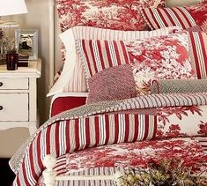 Love the red toile and stripes bedding