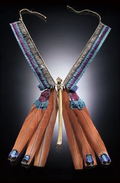 Brazil | Necklace with attached flute   from the Para State. ca. 1955 - 60s. | Macaw feather/feathers, cotinga scalp/scalps, canvas, bird bone/bones, cordage    Courtesy of National Museum of the American Indian