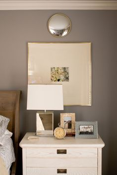 Love this vignette. Love the large matted, gold framed picture. Love the combination of silver and gold, antique with modern, just a great eclectic mix.