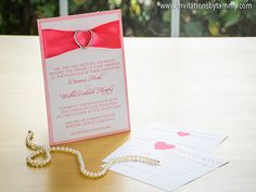 Light Pink Invitation with Coral Ribbon and Silver Heart Rhinestone Buckle, featuring a pocket on back with insert cards