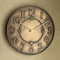 Exhibition Font Clock~ Mark the hours with the font Wright invented for his exhibition drawings in the 1930's. This new design from Bulova is finely crafted in cast resin with raised numerals and an antique bronze metallic finish. Indoor use only.  $74.00