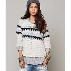 Last chance Free People Fair Isle Sweater I'm sending a ton of my stuff to same day consignment this weekend and This gorgeous sweater is one of them. Classic chunky knit sweater features a striped design and a boxy silhouette.Round neck and long sleeves. Ribbed accent at neckline. High-low hem. 53% acrylic, 26% wool, 9% cotton, 7% polyester, 5% alpaca. Hand wash cold, dry flat. Imported. Measurements: Length: 27 in Free People Sweaters