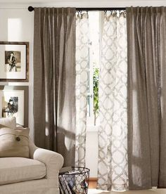 You could go for a layered look with your curtains - a heavier linen and then a patterned sheer fabric behind. It creates texture and would perfectly accompany the chevron rug if you get that.
