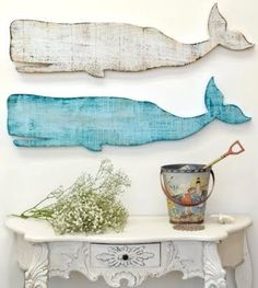 Paint distressed wood cut out in the shape of whales to add a coastal element to an elegant, historic-seaside themed hallway.