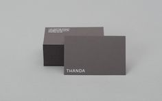 Brand identity and white foiled business cards by UK graphic design studio Karoshi for conscientious interior accessory business Thanda