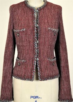 Chanel. Wool. Note the gently sagging pockets--as per Claire Shaeffer, this is very typical of Chanel cardigan jackets as the pockets are unlined and often feature buttons or similarly-weighty trim.