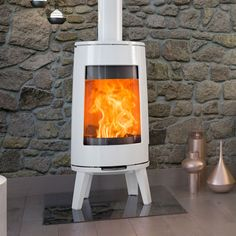 The Dovre Bold 300 Wood Burning Stove features a tall firebox with a curved viewing window which offers a truly contemporary style. The Dovre Bold 300 rests on a four-point stand and is available in Matt Black, Pure White Enamel or Grey Enamel Barn Apartment, Apartment Ideas, Types Of Houses, Nordic Style, White Enamel, Wood Burning, Contemporary Style, Home Appliances, Pure Products