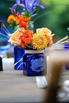 blue jars/ orange flowers