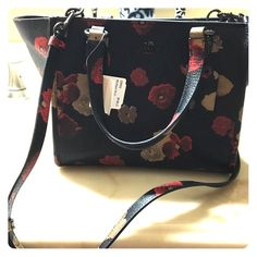 Coach Crosby Crossbody Can be worn crossbody or long strap can be removed to carry as a small tote. It has a textured leather. Style #33856 BNBNC It is black with a red and nude floral background. Coach Bags Crossbody Bags