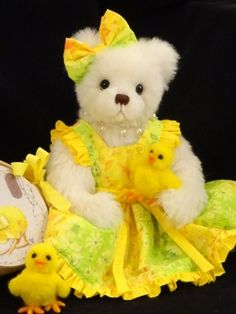 White bear, dressed in yellow, with cute baby ducks